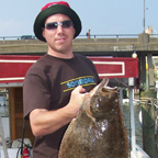 Guy with huge flounder.