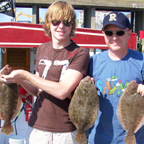 Boy and dad with three nice flounder.